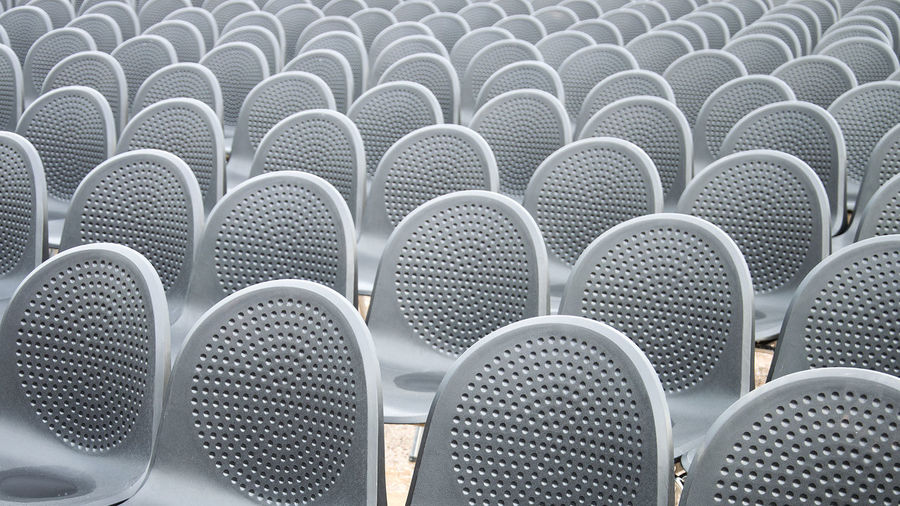 Backgrounds Chair Seat Full Frame In A Row No People Pattern Repetition Indoors  Textured  Architecture Close-up Machinery Empty Built Structure Appliance Circle Order Gray Silver Colored