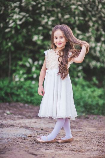 Portrait of teenage girl standing outdoors