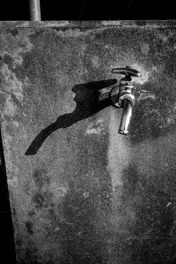 Tap Faucet Shadow High Angle View Sunlight