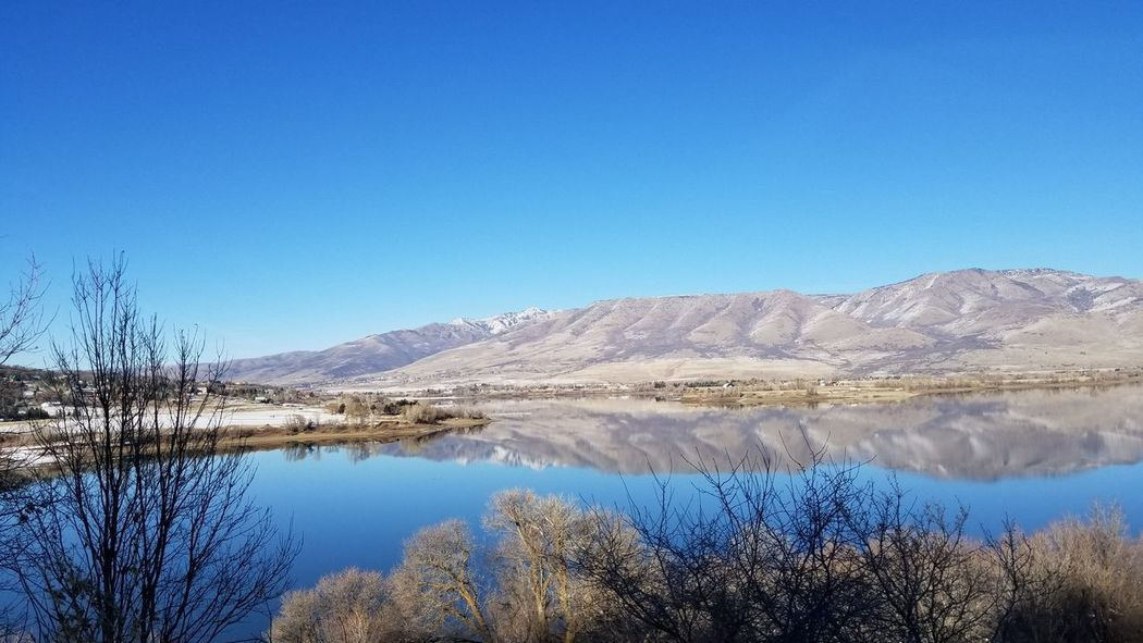 Landscape_photography Pineview Dam Huntsville Utah Blue Sky Cold Temperature Cold Weather Lake Blue Scenics Nature Reflection Water Clear Sky Beauty In Nature Tranquility Tranquil Scene Sky Mountain Landscape Tree Outdoors Day