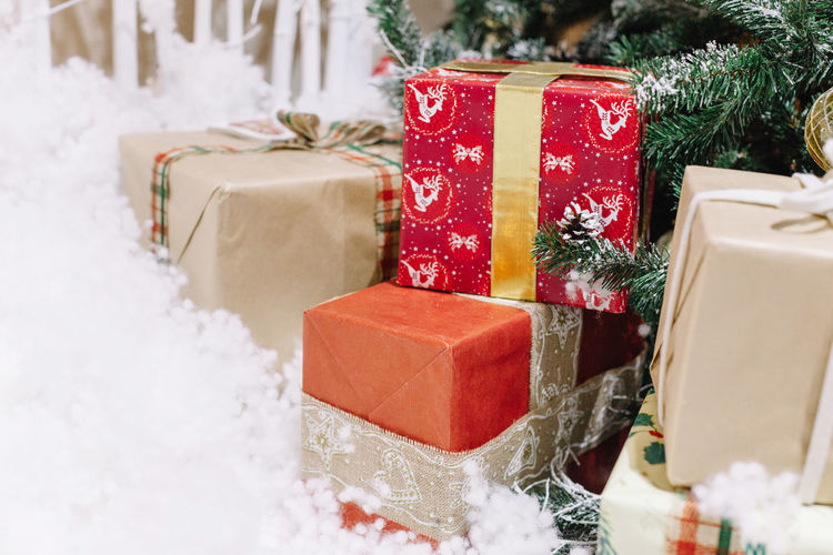 Presents by christmas trees
