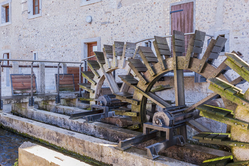 Series of three wheeled wooden mill . Agriculture Alternative Energy Architecture Day Hydroelectric Power No People Outdoors Water Wheel Watermill