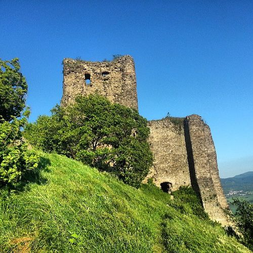Old ruin castle against blue sky