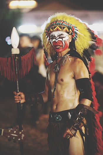 Man Looking Away While Wearing Tribal Costume At Night