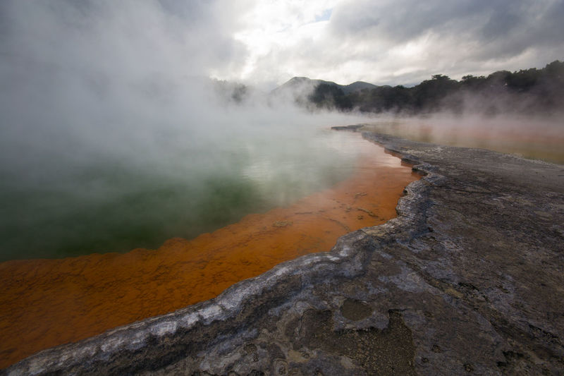 Scenic view of steam emitting from hot spring