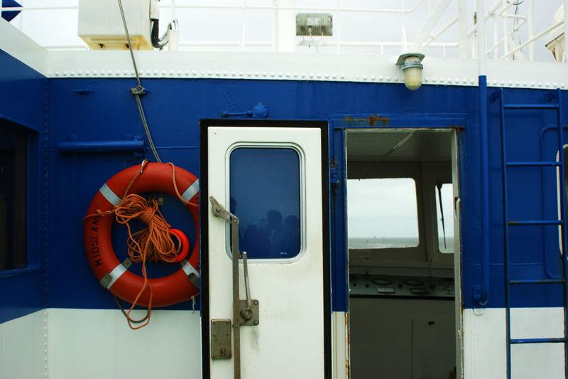 Close-Up Of Life Belt On Blue Boat