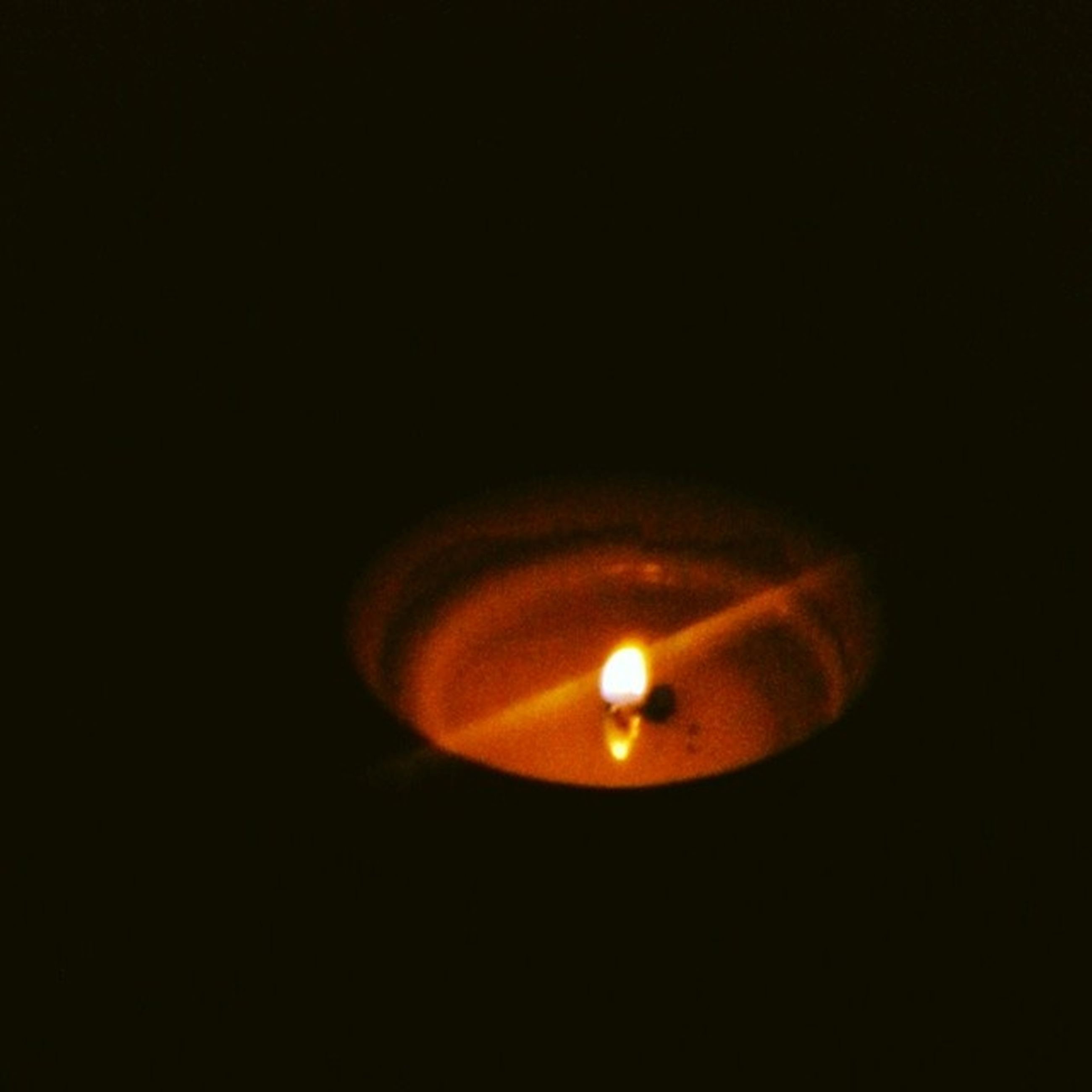 illuminated, copy space, dark, glowing, indoors, studio shot, black background, lighting equipment, lit, darkroom, night, burning, electricity, flame, close-up, light bulb, candle, light - natural phenomenon, light, heat - temperature