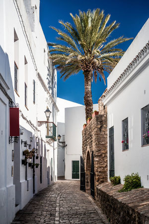 Narrow street of Vejer de la Frontera. Costa de la Luz, Spain Andaulcia Architecture Building Exterior Buildings Cobblestone Streets Costa De La Luz Cádiz, Spain Day Famous Place Houses Narrow Street No People Outdoors Perspective Picturesque Village Pueblo Blanco Rustic Sky SPAIN Town Travel Destinations Vejer De La Frontera  Village Whitewashed Whitewashed Houses