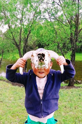 Mongolia NOMAD Skull Portrait Leisure Activity Lifestyles Nature Childhood Day Plant Front View Green Color Child Portrait Grass Waist Up Real People One Person Looking At Camera Outdoors Casual Clothing Men Mask Disguise The Great Outdoors - 2019 EyeEm Awards The Portraitist - 2019 EyeEm Awards
