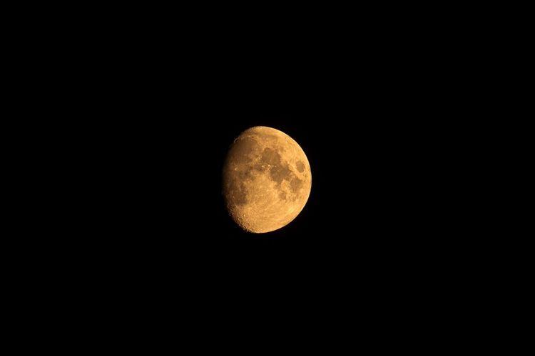 Scenic view of moon against dark sky