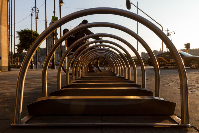 Bike rack in Zócalo in Mexico city, at dawn on empty streets Bicycle Bicycle Rack Bike Bike Life Bike Rack Calm City Life City Lights City Street City View  Dawn Dawn Light Early Morning Light And Shadows Mexico City Morning Morning Light Patterns Sunlight And Shadow Symmetry