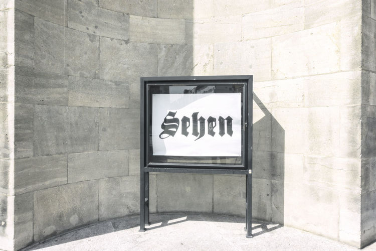 Sign reading 'Sehen' at Volksbühne Berlin Berlin Color Image Germany 🇩🇪 Deutschland Horizontal Outdoors Sehen Shadow Sign Slogan Volksbühne Wall