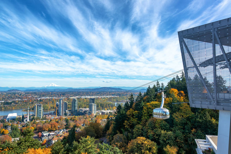 Portland Aerial Tram with a view of Portland, Oregon with Mt. Hood in the background Portland Oregon No People Outdoors Cityscape Travel Tourism Travel Destinations Building Exterior Built Structure Architecture Sky City Building Nature Office Building Exterior Skyscraper Pacific Northwest  Northwest Willamette River  River Blue Sky Skyline Urban Skyline Urban Ohsu Aerial Tramway Aerial Tram Overhead Cable Car Gondola Day Cloud - Sky Mt Hood Fall Autumn United States USA
