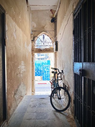 Bicycle in alley amidst buildings