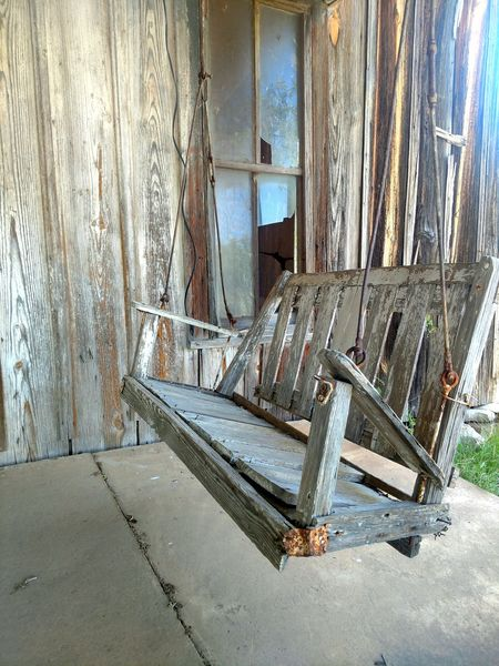 To be able to hear the stories told in this swing. Weathered Wood Cabin Cabin In The Woods Texas Swing Swings Porch Wooden Wooden Swing Porch Swing Abandoned Abandoned Places Abandoned & Derelict Abandoned House Abandoned_junkies Abandoned Architecture Worn Out Weathered Damaged Bad Condition Deterioration Broken Run-down Decline