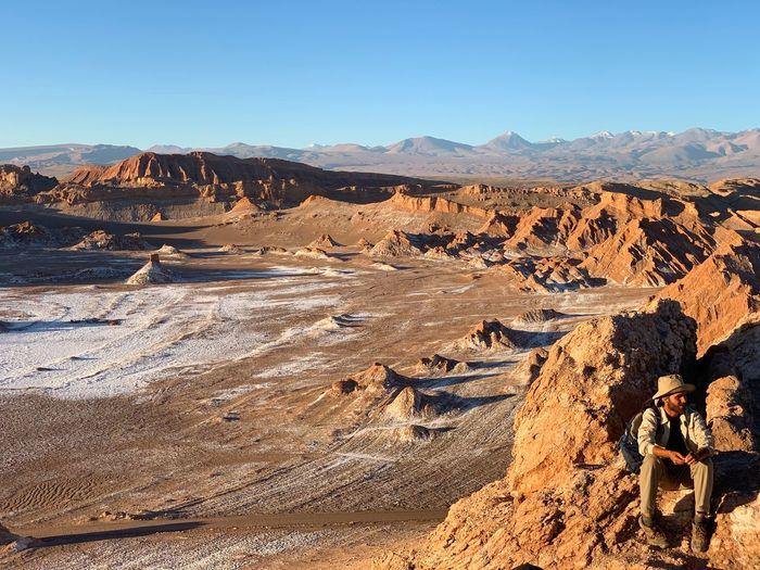 Scenic view of dramatic landscape against clear sky at valle de la luna atacama desert