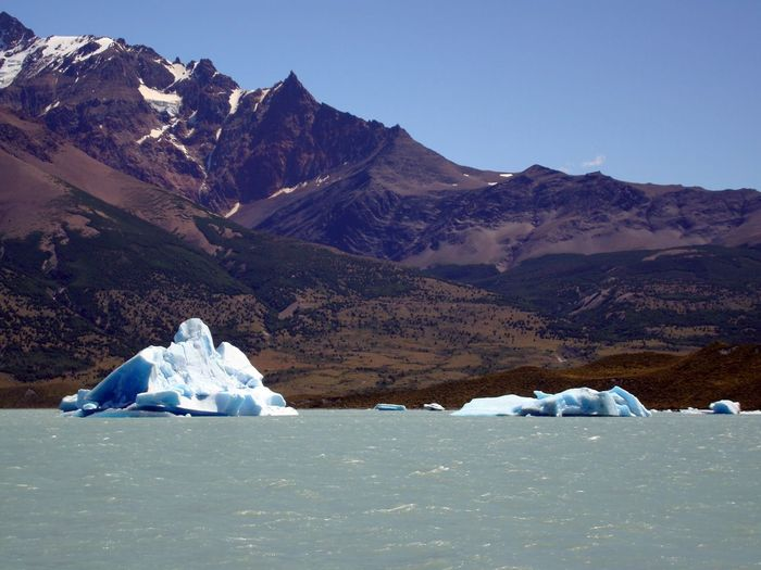 Scenic View Of Glacier And Mountains Against Sky