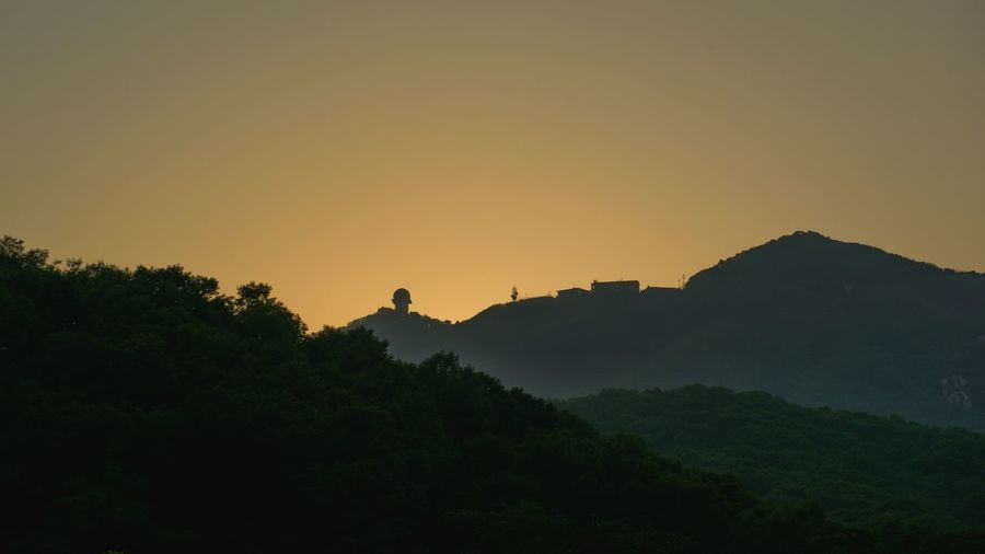 Radar dome on the mountain after sunset