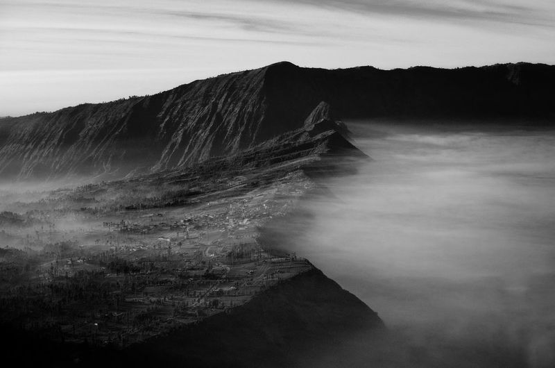 Mount Bromo, is an active volcano and part of the Tengger massif, in East Java, Indonesia.  Black&white Black And White Fine Art Amazing Amazing View Fine Art Photography INDONESIA Mount Bromo Bromo Mountain Fog Sand Dune Sky Landscape Volcanic Landscape Bromo-tengger-semeru National Park