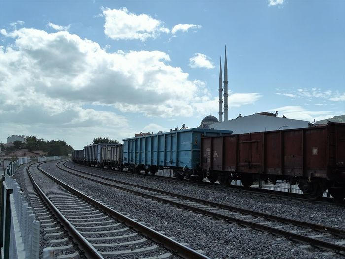 Train on railroad tracks against sky