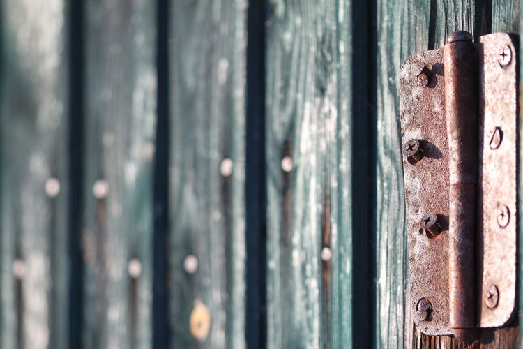 Full Frame Shot Of Door With Rusty Metallic Hinge