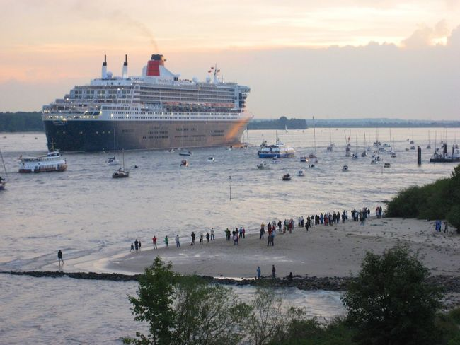 Departing Elbe River Ocean Liner Cruise Ship Nautical Vessel Queen Mary II Large Group Of People Real People Sea Men Nature Sky Water Sunset Lifestyles Beach Vacations Outdoors Scenics Crowd Day