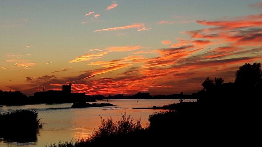 fire in the sky Fireinthesky Sunset Water Silhouette Tree Reflection Mountain Orange Color Dramatic Sky Sky Cloud - Sky