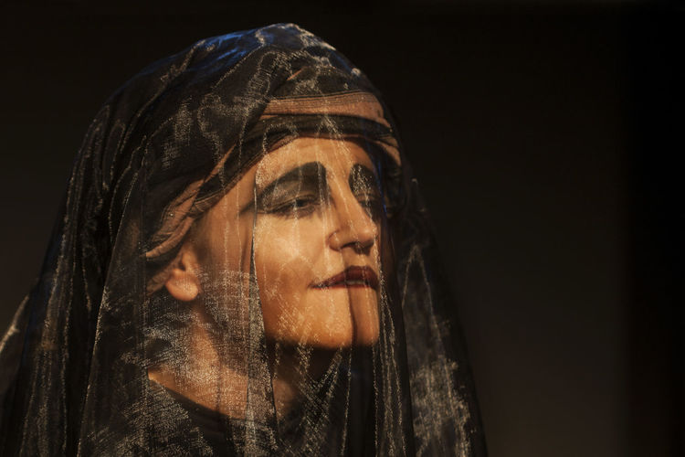 Close-Up Of Performer Wearing Veil In Theater