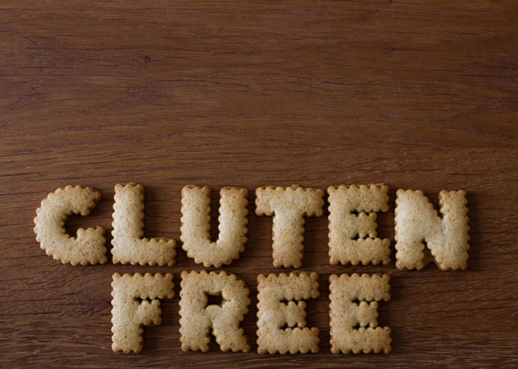 The phrase Gluten Free created from alphabet shaped cookies with copy space above and on a wooden background. Advice Alphabet Baking Biscuits Bread Breads Cookies Food Food Advice Food Porn Foodporn Gluten Gluten Free Glutenfree GlutenFreeFood Glutenfrei Healthy Healthy Eating Healthy Food Healthy Lifestyle Sweet Food Temptation Wooden Wooden Background Words