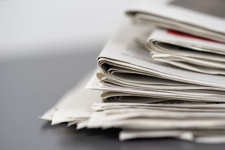 Close-up of newspapers on table