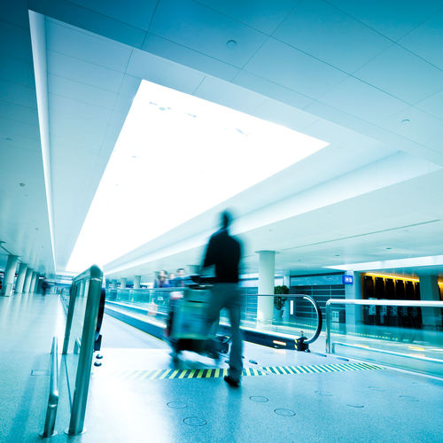 Blurred motion of people walking in airport