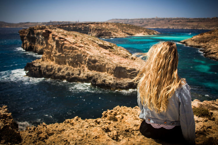 Adult Adults Only Beach Beauty In Nature Blue Bluelagoon Coastline Day Horizon Over Water Leisure Activity Malta Nature One Person One Woman Only Only Women Outdoors People Scenics Sea Sky Water Women Young Adult Traveling Home For The Holidays EyeEmNewHere