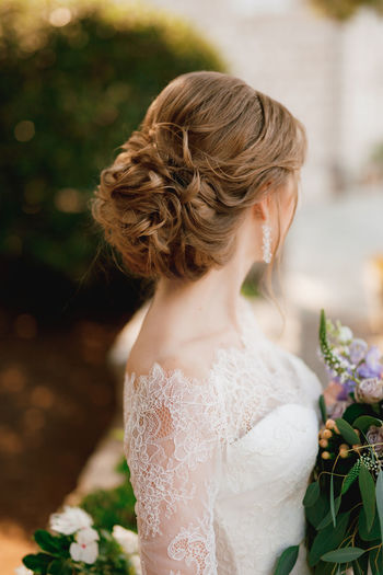 Close-up of bride looking away while standing outdoors