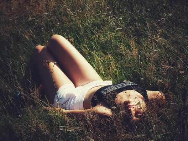 Beautiful Woman Day Field Grass High Angle View Land Leisure Activity Lifestyles Lying Down Lying On Back Nature One Person Outdoors Plant Real People Relaxation Resting Sunlight Women Young Adult Young Women
