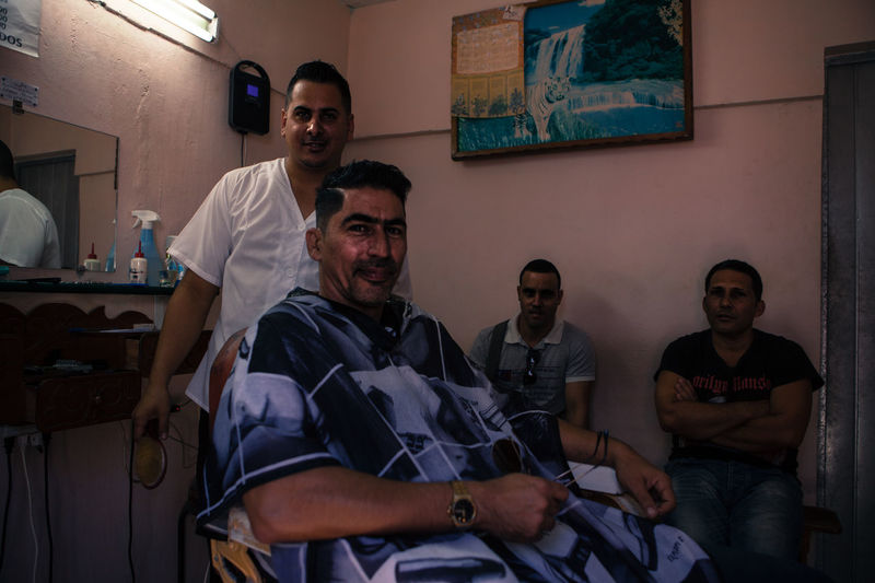A barber works at his shop in Cienfuegos, Cuba. Barber Barberlife Barbershop Cienfuegos Cienfuegos, Cuba Cuba Cuban Cuban People Frendly Person Portrait Portrait Photography Travel Traveling