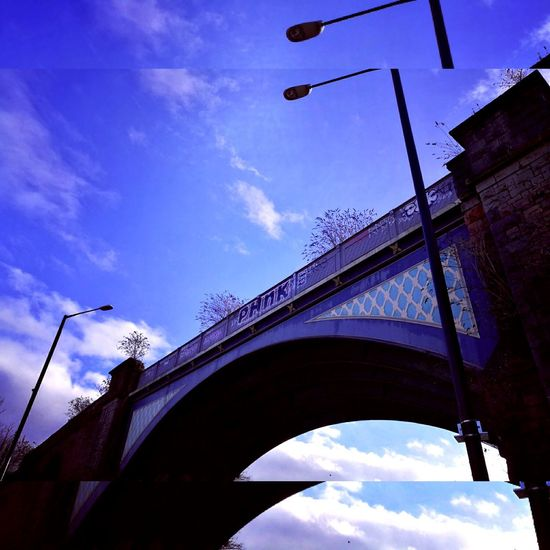 Urban railway bridge Adapted To The City The Arches Railway Bridge Winter Trees Bare Branches Blue Winter Sky Bridge - Man Made Structure Low Angle View Sky City No People Outdoors Architecture Lamposts Nature And City Bristol Uk artistic Urban Views Graffiti Writers Winter 2017 History Landmarked EyeEm New Here