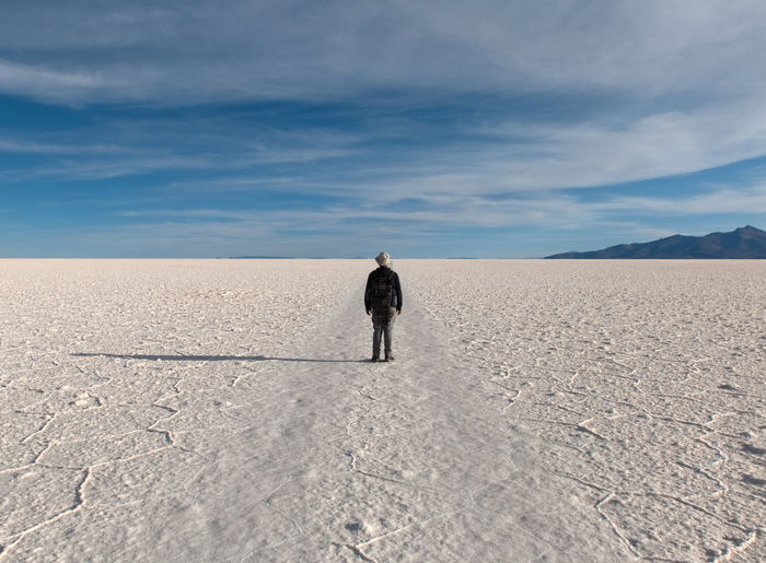 It's About The Journey One Person Sky Rear View Men Scenics - Nature Full Length Desert Land Nature Tranquil Scene Real People Cloud - Sky Environment Climate Remote Day Salt Flat Beauty In Nature Adult Arid Climate