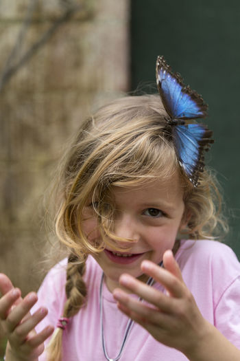Little girl with a butterfly on her hair Females Animal Themes Beauty In Nature Blond Hair Butterfly Caucasian Ethnicity Child Childhood Cute Day Fauna Focus On Foreground Front View Gigle Girls Hair Hairstyle Headshot Innocence Insect Portrait Smile Waist Up Wildlife
