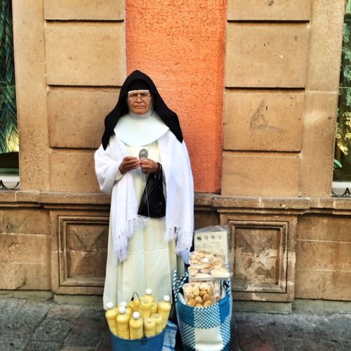 Mexico Guanajuato, México Urban Photography IPhoneography Photojournalism Eye4photography  Streetphotograhy Onassignment Daily Life Nuns A #nun #knitting in the historic downtown while selling homemade #Rompope which is an eggnog-like drink made with eggs, milk, and vanilla flavouring and cookies, according to locals both are very delicious. / Una #monja teje mientras vende rompope . o licor de huevo es una bebida preparada con yemas de huevo, vainilla, canela, almendra molida, leche, azúcar y licor. Es de color amarillo y consistencia espesa asi como galletas de nata en el centro historico, los de la zona dicen que ambos son deliciosos. #OnAssignment #Leon #Guanajuato #Mexico #EverydayMexico #LatinAmerica #EverydayLatinAmerica #iphoneography #Eye4photography #photojournalism #streetphotography #NorthAmerica #JuanCarlos #2015copyright