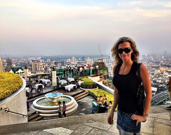 Lifestyles Young Adult Leisure Activity City Young Women Cityscape Sky Casual Clothing Cloud - Sky Vacations City Life Enjoyment Focus On Foreground Confidence  Skyscraper Rooftops Lebua Lebuastatetower Bangkok Thailand Upscale Living Luxurylifestyle  Steps