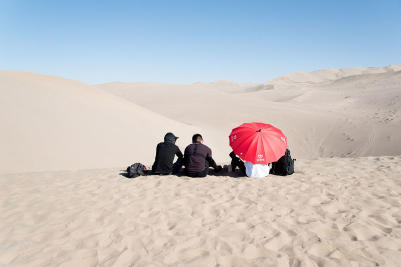 The Singing Sand Dunes of Dunhuang, Gansu, China ASIA Dessert Gobi Desert Silk Road Adult Arid Climate China Clear Sky Day Desert Friendship Full Length Gansu Leisure Activity Lifestyles Mammal Men Nature Outdoors People Real People Sand Sand Dune Sitting Sky Togetherness Two People Women Connected By Travel Lost In The Landscape