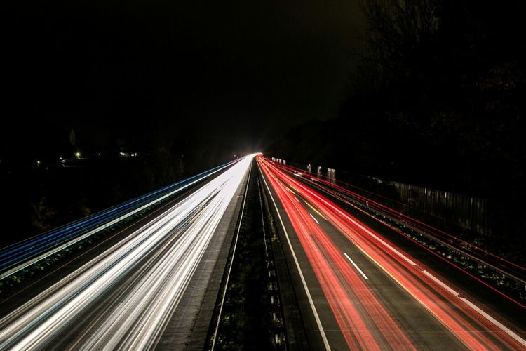 High angle view of light trails at night