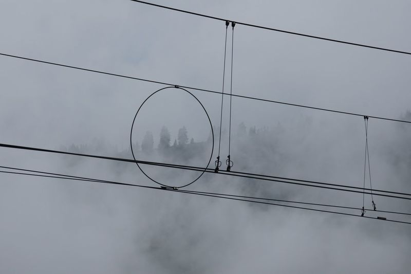 Electric cables during foggy weather
