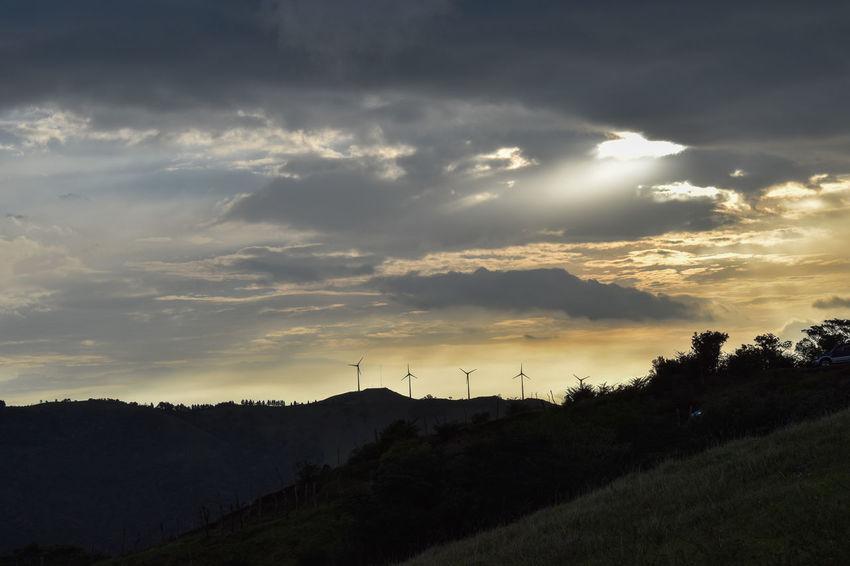 windmill & sunset Alternative Energy Cloud - Sky Costa Rica Costa Rica Sunset Costa Rica❤ Eolicas Eye4photography  EyeEm Nature Lover EyeEm Sunset Landscape Mountain Outdoors Sky Sunset Wind Turbine Wind Turbine Windmill Perspectives On Nature See The Light