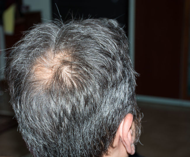 Close-Up Of Man With Gray Hair In Home At Night