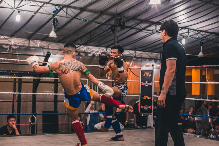 Striking hard and fast Sport Exercising Healthy Lifestyle Men Sports Training Lifestyles Real People Determination Strength Adult Boxing - Sport Young Men Young Adult Athlete Motion Gym Vitality People Effort Fighting Muay Thai Kickboxing