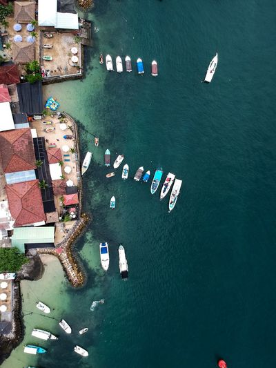 Drone View Of Boats Moored On Sea