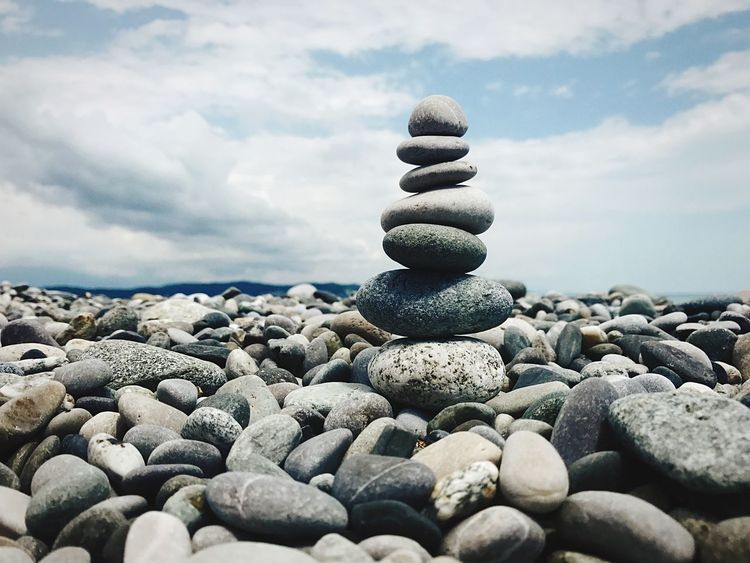 Solid Cloud - Sky Rock Stone - Object Pebble Sky Stack Nature Stone Balance No People Day Beauty In Nature Scenics - Nature Beach Tranquility Tranquil Scene Rock - Object Land Zen-like