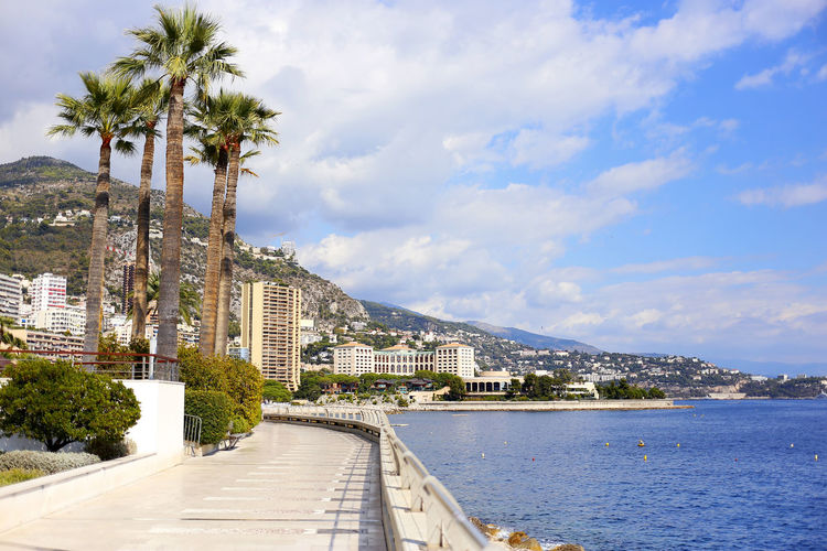 Architecture Azure Beach Beauty In Nature Champion Promenade City Cloud - Sky Day Monaco Mountain Nature No People Outdoors Palm Palm Tree Road Sea Sky Travel Destinations Traveling Tree Water