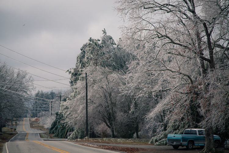 Ice storm Blue Cold Cold Temperature Composition Day Frozen Ice Storm It's Cold Outside Landscape Leading Non-urban Scene On The Road Outdoors Perspective Remote Scenics Solitude The Way Forward Tranquil Scene Tranquility Tree Trees Vintage Cars Winter Wires